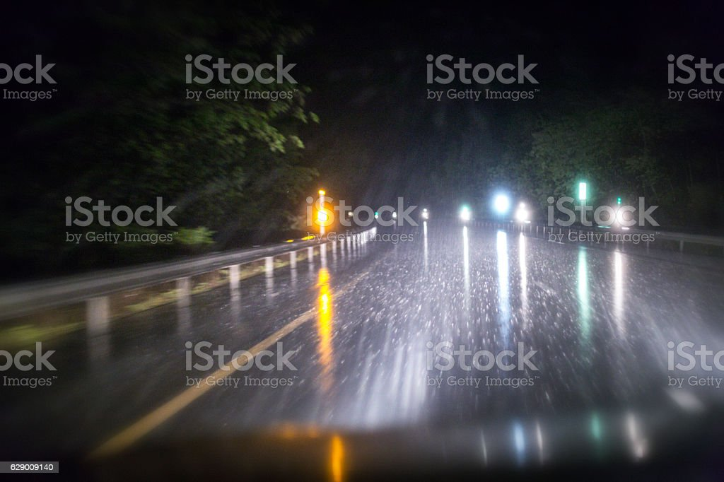 Night Road Marker Lens Flare Reflectors Through Speeding Car Windshield stock photo