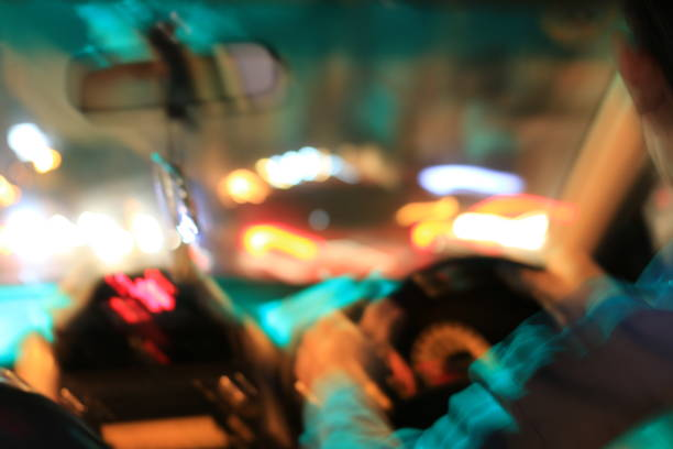night road view from inside car natural light street and other cars is motion blurred, blur image from inside a car traveling at night time. - impaired driving stock photos and pictures