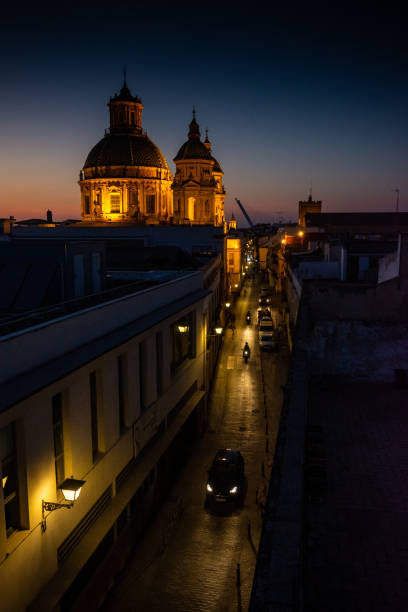 Night rooftop view of Church of Saint Louis of France, Seville, Spain stock photo