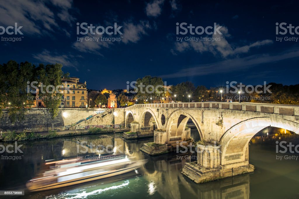 Night scape of  the ancient Roman Bridge at night. Ponte Sisto is a footbridge in Rome's historic centre over the Tiber river. Rome, Italy. stock photo