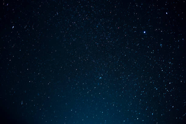 Night scape with beautiful stary sky at the high mountain. Star texture. Space background. stock photo