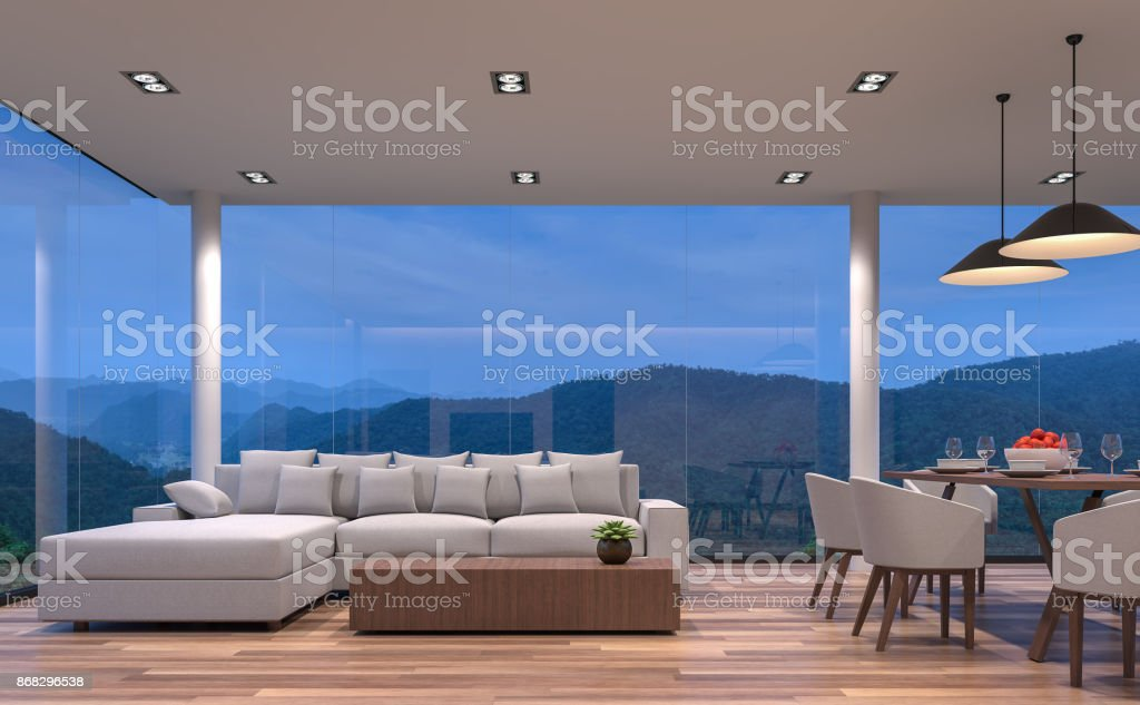 Night scene glass house living and dining room with mountain view 3d rendering image stock photo