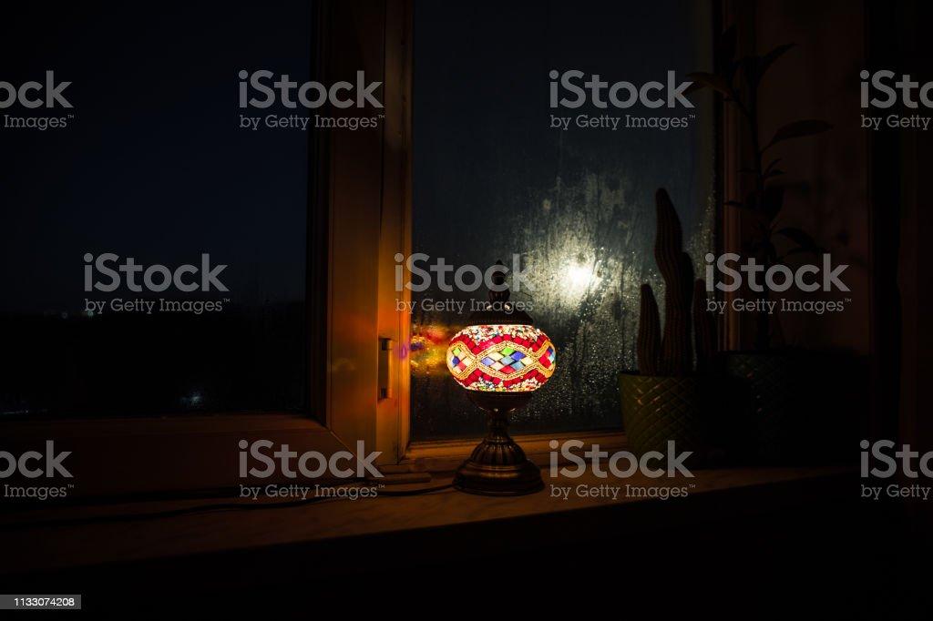 Night scene of Moon seen through the window from dark room. Night sky...