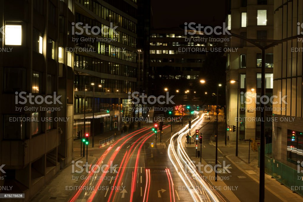 Night scene of street with traffic in London city stock photo