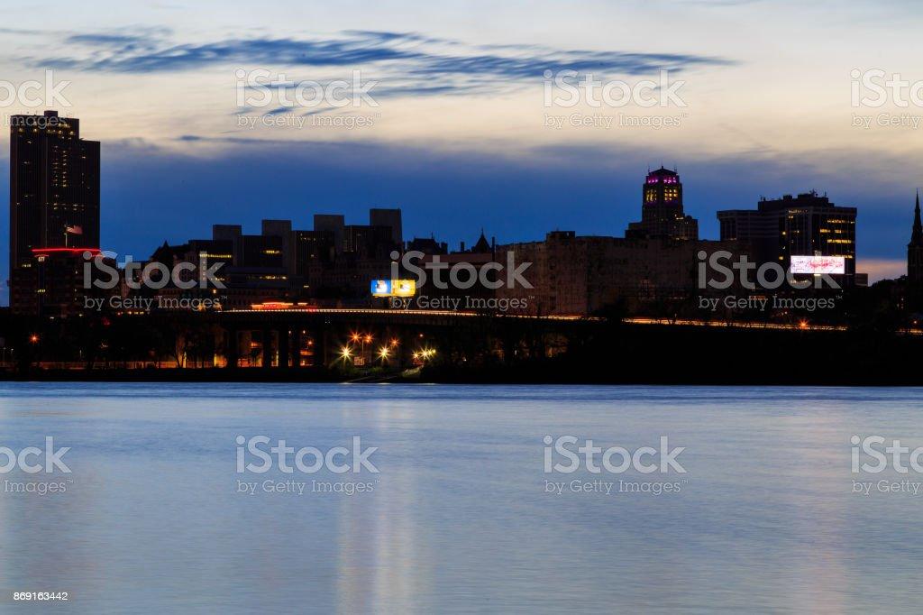 Night scene of urban Albany from Rensselaer docks across Hudson River stock photo