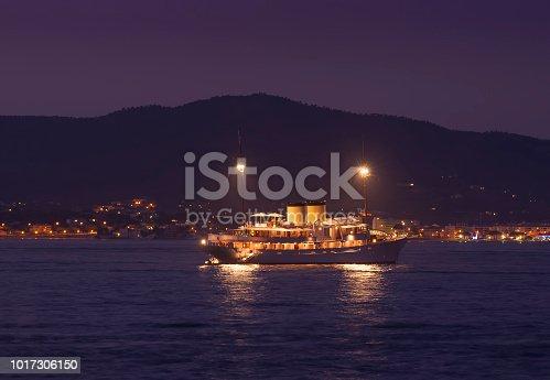 night scene of vintage boat on the sea