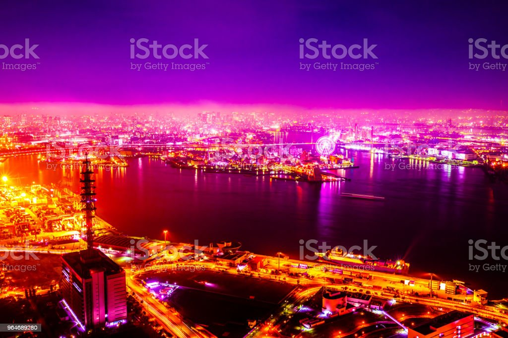 Night sea and horizon and town and Ferris wheel royalty-free stock photo