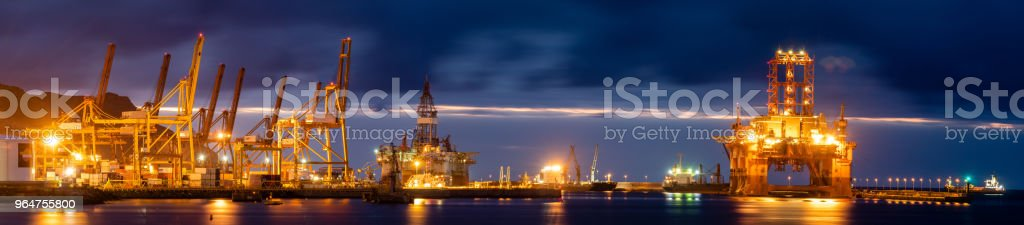 night seaport, container terminal and oil rig royalty-free stock photo