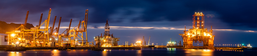 Night Seaport Container Terminal And Oil Rig Stock Photo - Download Image Now