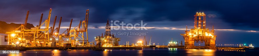 Night Seaport Container Terminal And Oil Rig Stock Photo & More Pictures of Blue