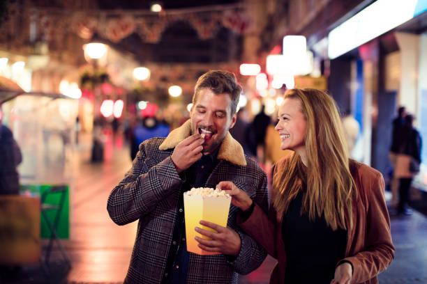 Night Shopping Close up of a young couple shopping in the city at night date night romance stock pictures, royalty-free photos & images