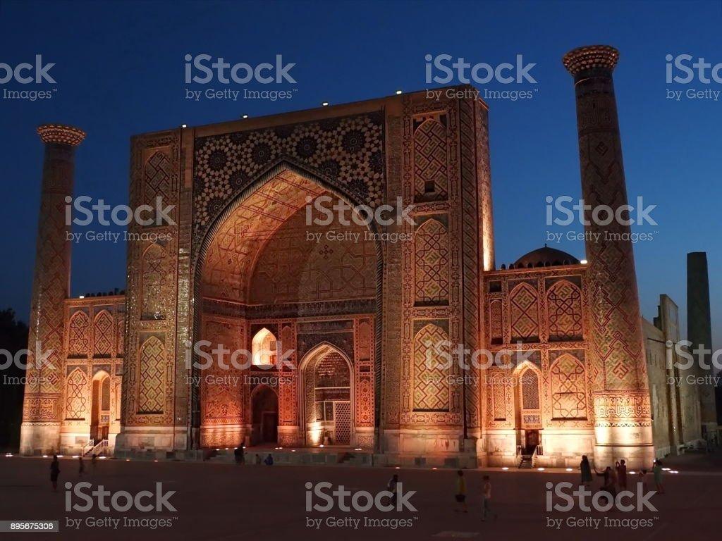 Night shot from Registan Square of Sher Dor Madrasah, Samarkand, Uzbekistan stock photo