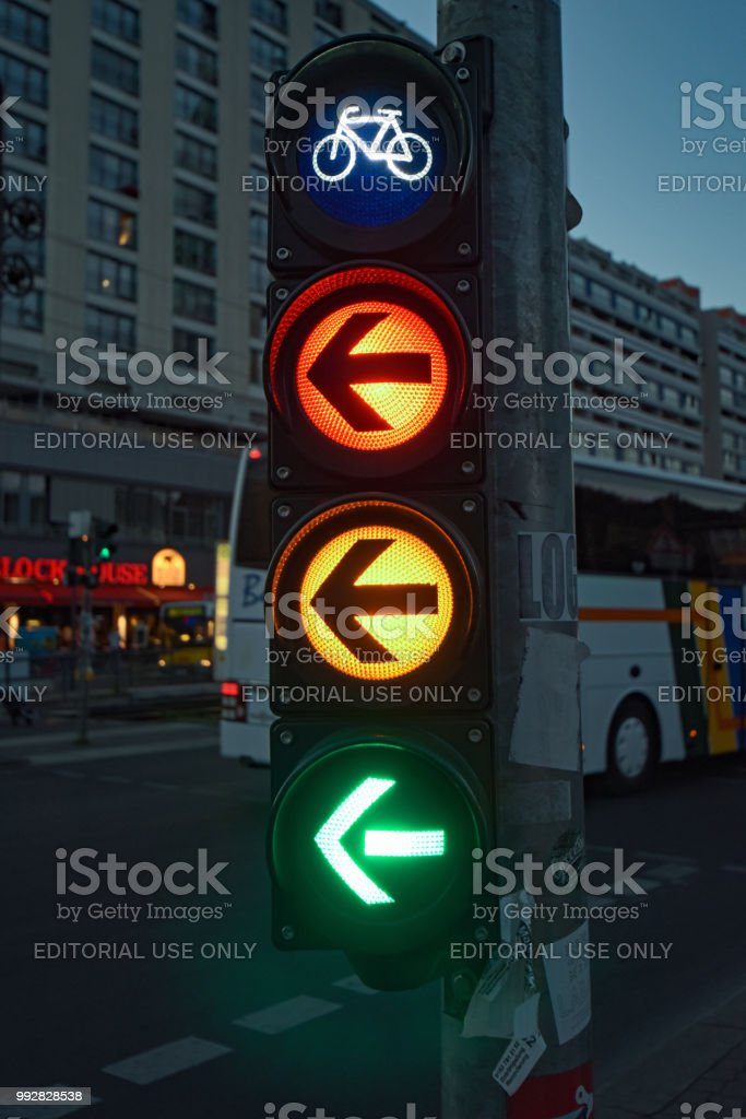 Night shot of a bicycle traffic light in the city center of Berlin,...