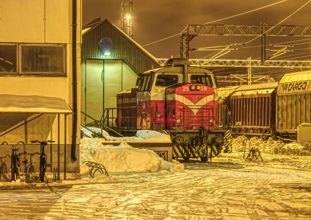 Night shot of a diesel freight locomotive in Rauma, Finland stock photo