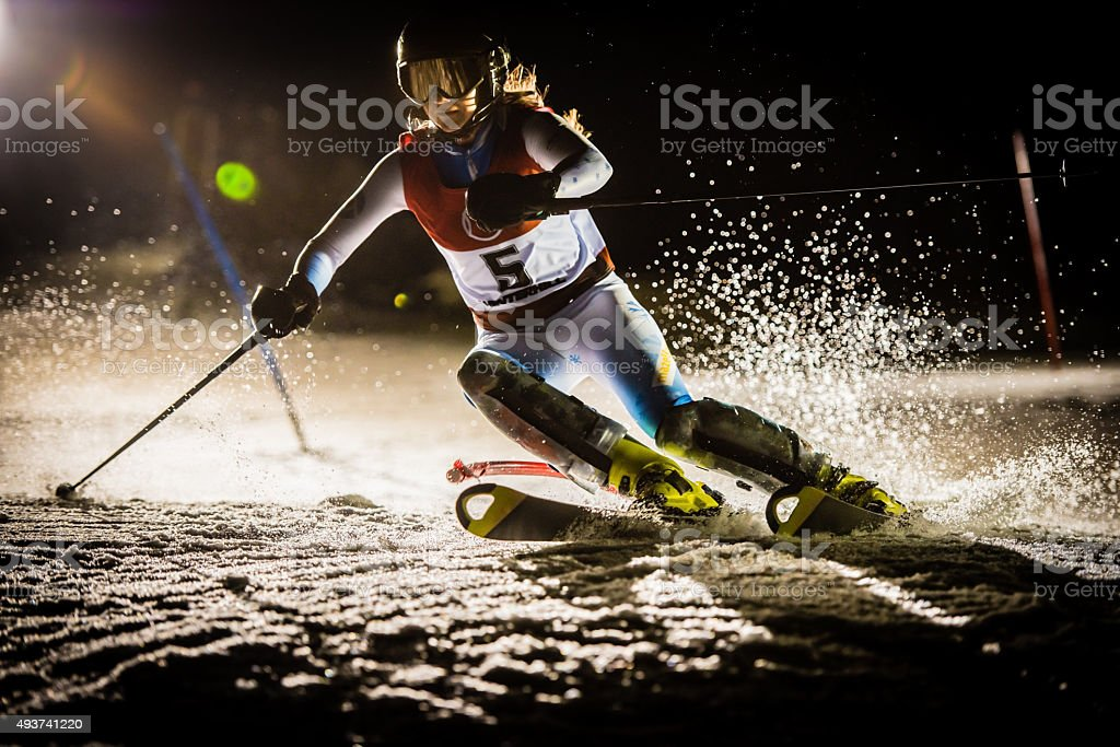 Night Shot of a Professional Alpine Skier Training stock photo