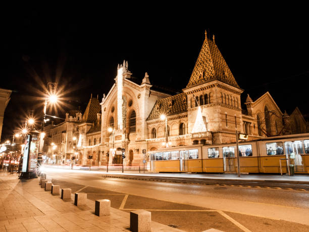 Night shot of historical building of Central Market Hall in Budapest, Hungary Night shot of historical building of Central Market Hall in Budapest, Hungary. market hall stock pictures, royalty-free photos & images
