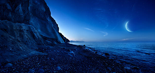 Night shot of mountains and sea stock photo