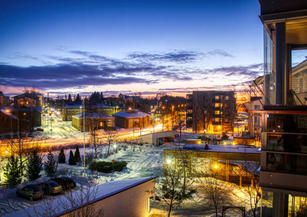 Night shot over the rooftops of the snowy Finnish town of Rauma stock photo
