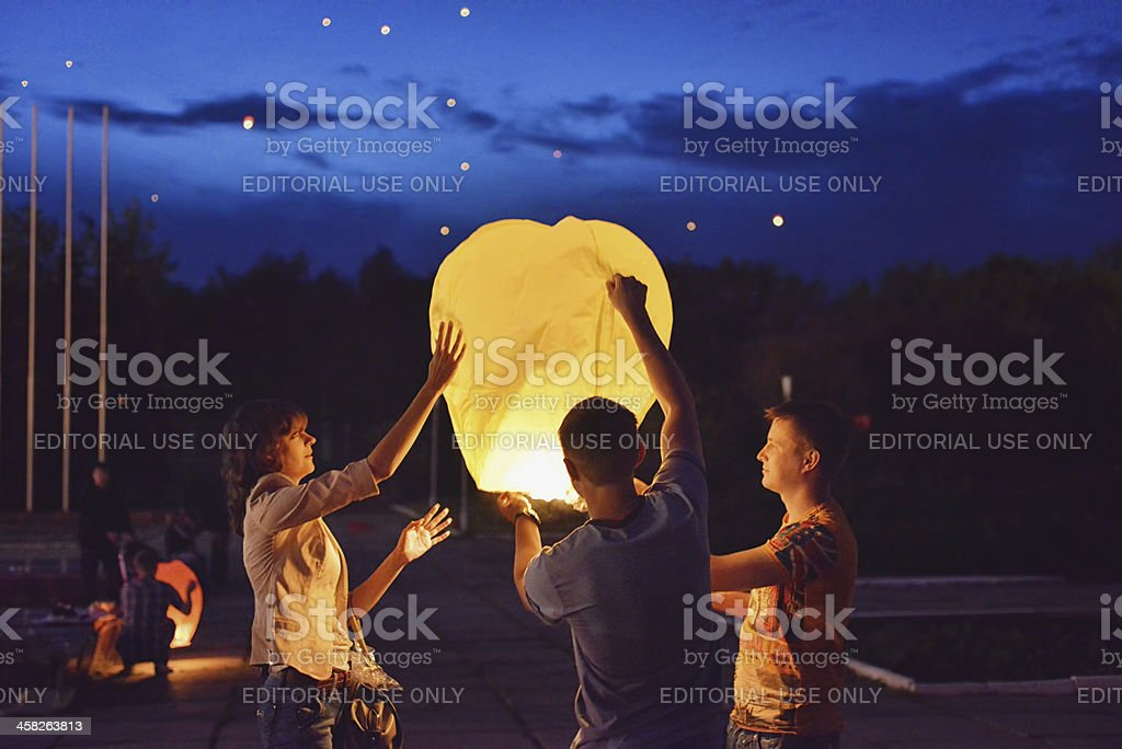 Night Show Launch Chinese lanterns into the sky. Unforgettable feelings. stock photo