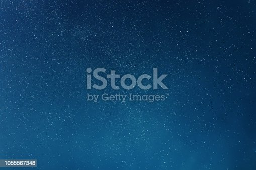 istock Night sky backgrounds with stars and clouds 1055567348