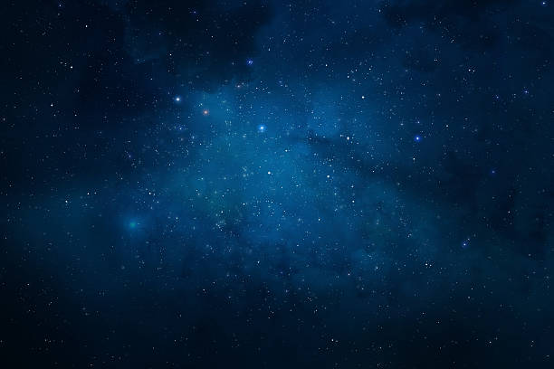 night sky filled with stars and nebulae - dark blue stock pictures, royalty-free photos & images