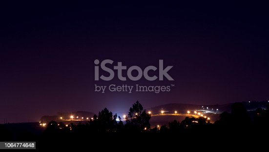 653506436 istock photo night sky galaxy mountains trails 1064774648