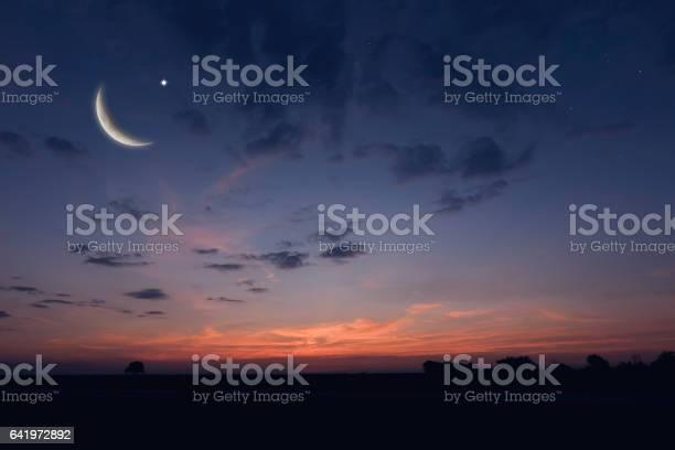 Photo of Night sky landscape and moon, stars, Ramadan Kareem celebration