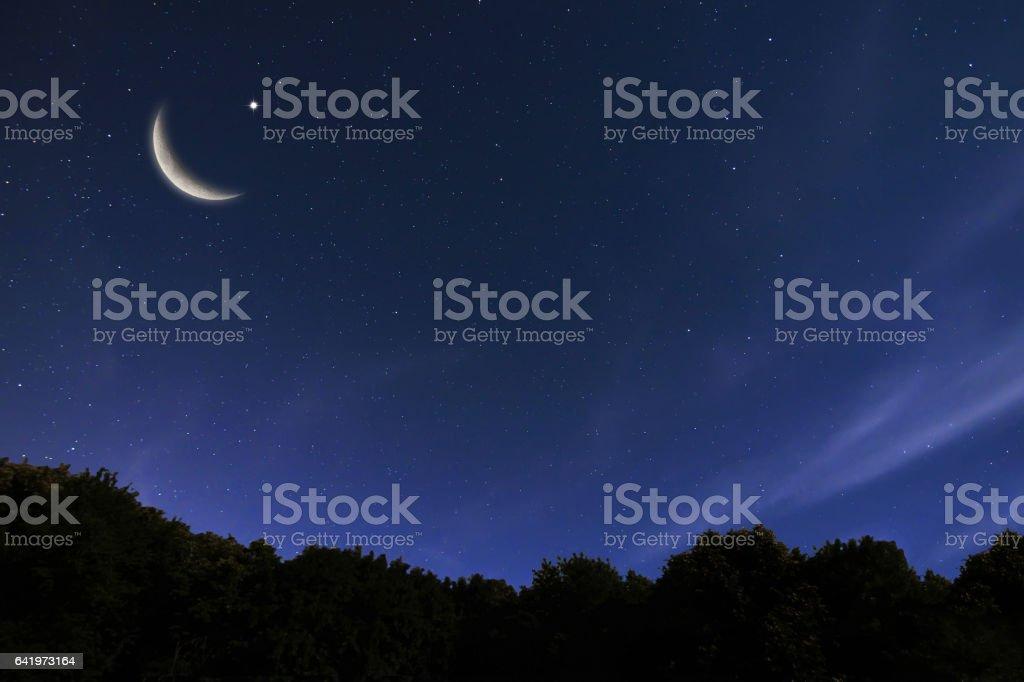 Night sky landscape and moon, stars, Ramadan Kareem celebration stock photo