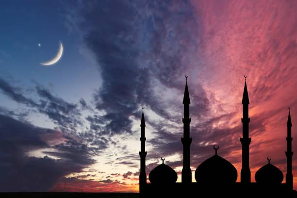 Night sky landscape mosque silhouette, Crescent moon stars, Ramadan Kareem celebration. stock photo