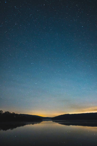 Night sky over rural landscape. stock photo