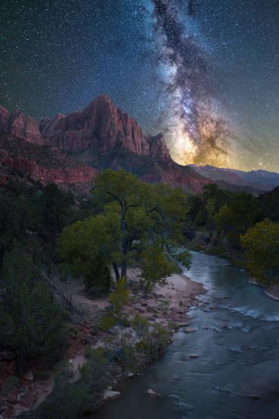 Night sky over scenic river stock photo