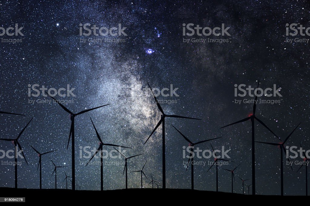 Night Sky Over Wind Farm. Energy and nature Night Sky. stock photo
