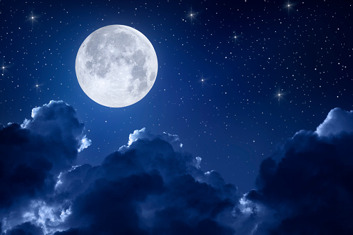Night sky with full moon, clouds and stars