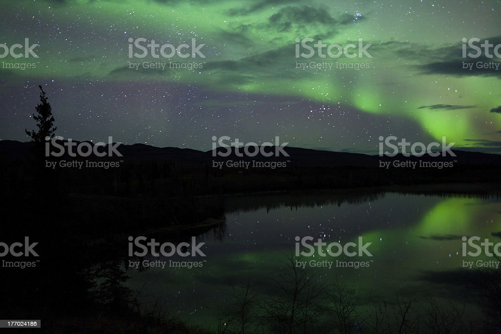 Night Sky Stars Clouds Northern Lights mirrored royalty-free stock photo