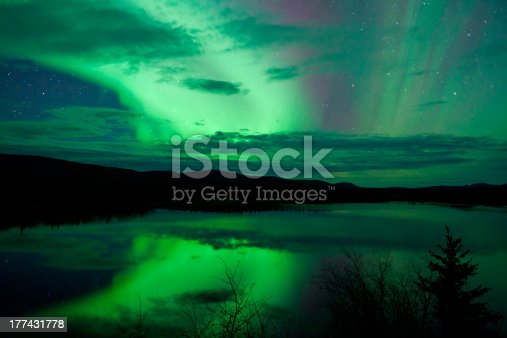 istock Night Sky Stars Clouds Northern Lights mirrored 177431778