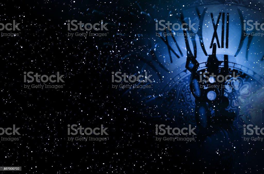 Night sky with a clock stock photo