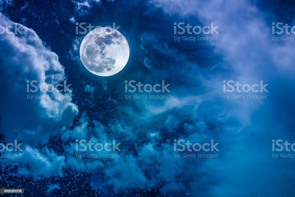 Night sky with bright full moon and cloudy, serenity nature background. stock photo