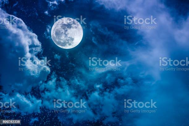 Photo of Night sky with bright full moon and cloudy, serenity nature background.