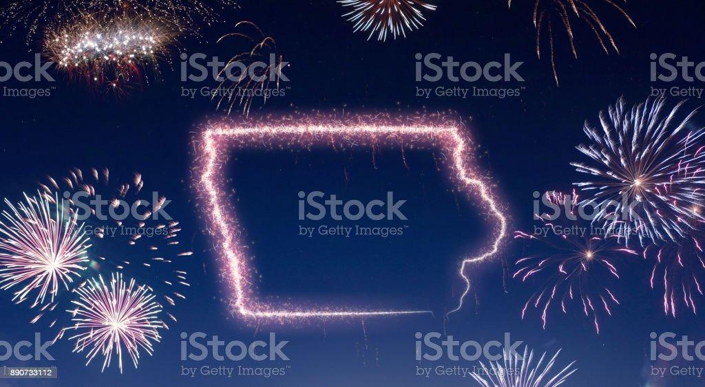 Night sky with fireworks shaped as Iowa.(series) stock photo