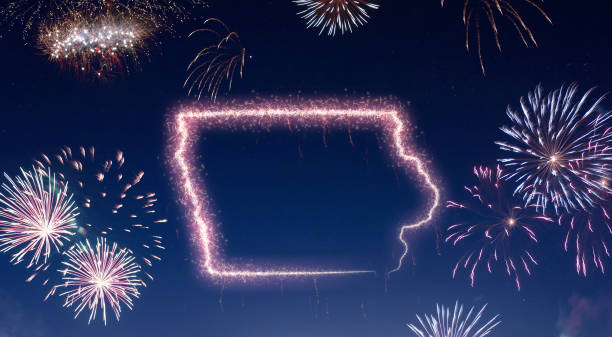 Night sky with fireworks shaped as Iowa.(series) stock photo