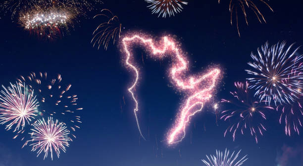Night sky with fireworks shaped as Quebec.(series) stock photo