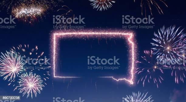 Night sky with fireworks shaped as South Dakota.(series)