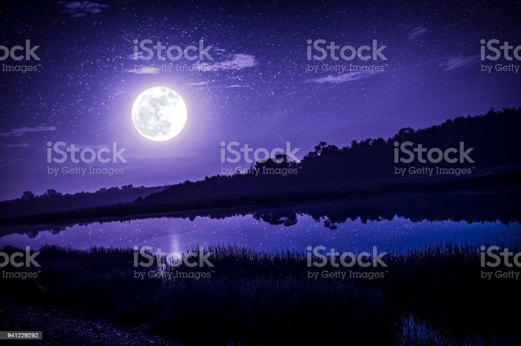 Night sky with full moon and many stars, serenity nature background. stock photo