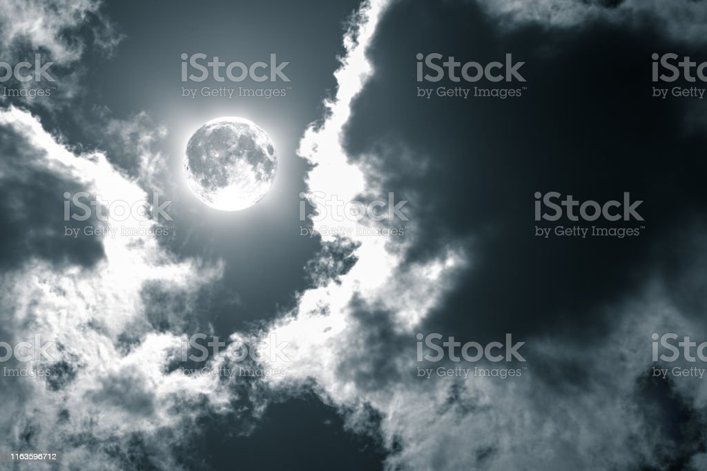 night sky with moon and dramatic clouds