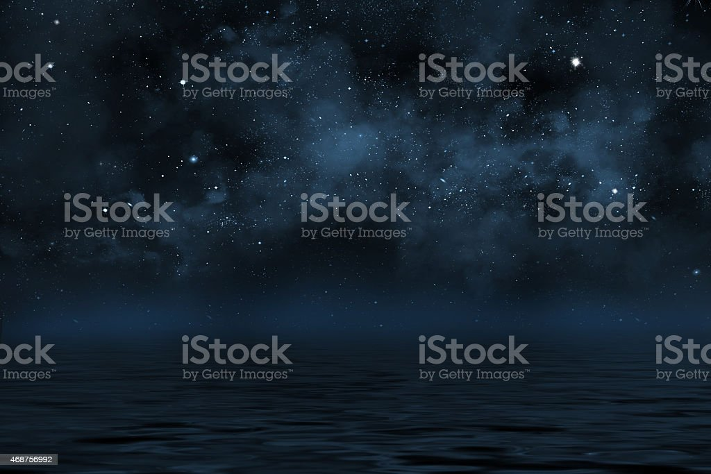 night sky with stars and blue nebula over water stock photo