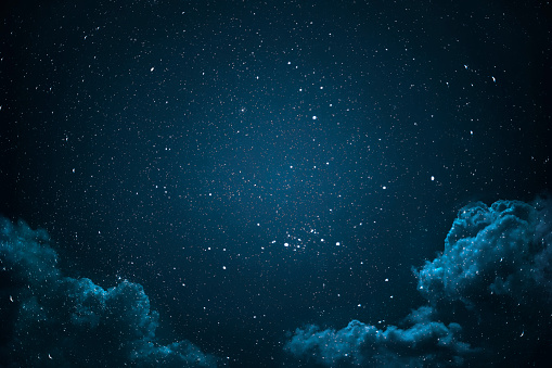 Night sky with stars and clouds.