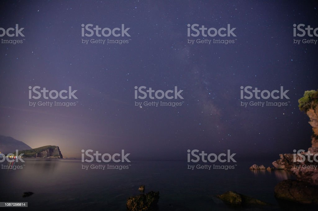 Night sky with stars and Milky Way above the sea. Montenegro