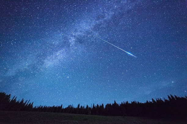 night sky,meteor shower - shooting stars stock photos and pictures
