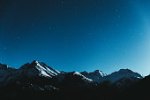 istock Night starry sky and Swiss Alps 1093158908
