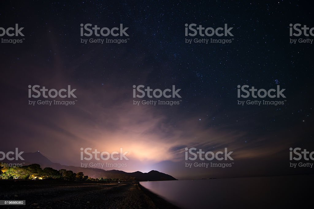Night starry sky at the sea coast in Cirali, Turkey stock photo